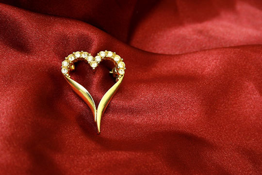 valentine jewelry on red silk
